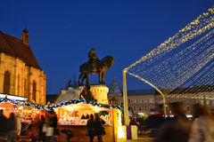 Christmas shopping at traditional market chalets. Royalty Free Stock Photos