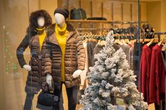 Christmas shopping. Christmas tree covered with snow in shopping mall Royalty Free Stock Photos