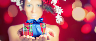 Christmas shopping with winter woman holding gift, hairstyle and makeup Stock Image