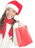 Christmas shopping woman. Isolated on white background royalty free stock images