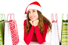 Christmas shopping woman daydreaming Stock Images
