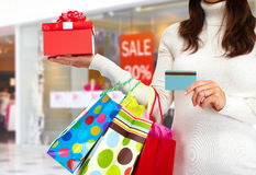 Christmas shopping woman with gift. Royalty Free Stock Image
