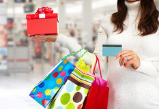 Christmas shopping woman with gift. Royalty Free Stock Photography