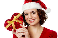 Christmas shopping, woman with gift. Royalty Free Stock Photography