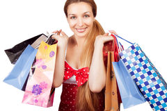 Christmas shopping - woman with present bags. Christmas shopping concept - happy woman with present bags stock image