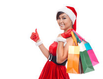 Christmas shopping woman thinking wearing santa hat and holding royalty free stock photography