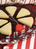 Christmas shortbread triangle cookies on vintage baking rack - vertical closeup. Royalty Free Stock Photography