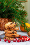Christmas shortbread with white chocolate and dried cranberries. Sweets, tangerines and nuts on the table Royalty Free Stock Photo