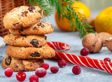 Christmas shortbread with white chocolate and dried cranberries. Sweets, tangerines and nuts on the table Royalty Free Stock Images
