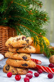 Christmas shortbread with white chocolate and dried cranberries. Sweets, tangerines and nuts on the table Royalty Free Stock Photography