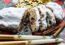 Christmas shtollen on a green background. Traditional German dessert.  royalty free stock image