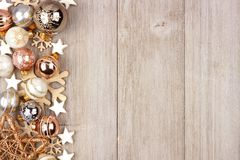 White and gold Christmas ornament side border on wood Royalty Free Stock Images