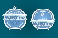 Christmas sign of blue hue with winter text. A Christmas sign of blue and white shades with a snowflake, with Santa Claus on deer and winter text, a set Royalty Free Stock Images