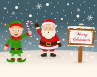 Christmas Sign - Green Elf & Santa Claus Royalty Free Stock Images