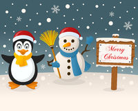 Christmas Sign - Penguin & Cute Snowman Royalty Free Stock Photo