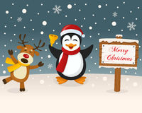 Christmas Sign - Reindeer & Cute Penguin Stock Images