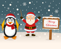 Christmas Sign - Santa Claus & Penguin Royalty Free Stock Images