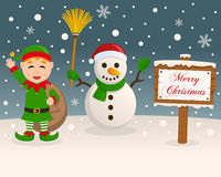 Christmas Sign - Snowman & Green Elf Stock Photo