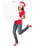 Christmas sign woman. Christmas sign excited woman looking happy and surprised. Funny asian caucasian female model standing full body isolated on white Stock Photos