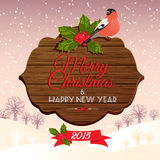 Christmas signboard with holly berry and bullfinch Stock Photo