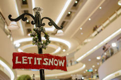 Christmas Signboard Let it snow. With blurred background stock photo