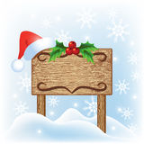 Christmas  signboard with santa hat Royalty Free Stock Image