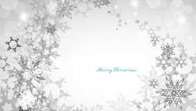 Christmas silver background with heart shaped snowflakes Royalty Free Stock Images