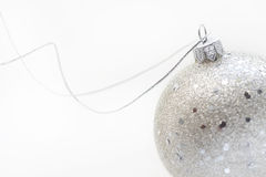 Christmas Silver Ball. Silver christmas ball with silver string Royalty Free Stock Photo