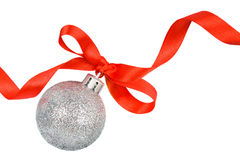 Christmas silver ball with red ribbon. Isolated on white Royalty Free Stock Photography