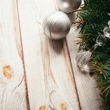 Christmas silver balls and fir branches on a wooden background. Christmas concept. Christmas silver balls and fir branches on a wooden background. Christmas Stock Photo