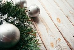 Christmas silver balls and fir branches on a wooden background. Christmas concept. Christmas silver balls and fir branches on a wooden background. Christmas Royalty Free Stock Photos
