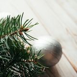 Christmas silver balls and fir branches on a wooden background. Christmas concept.  Stock Photography