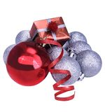 Christmas silver balls, red ribbon and red gifts Royalty Free Stock Photo