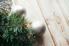 Christmas silver balls, tinsel, fir branches on a wooden background. Christmas concept.  Royalty Free Stock Photography