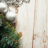 Christmas silver balls, tinsel, fir branches on a wooden background. Christmas concept.  Royalty Free Stock Photos