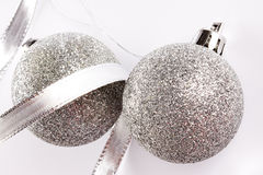 Christmas silver balls on white background Stock Images