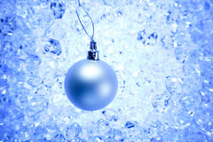 Christmas silver bauble on blue winter ice Royalty Free Stock Image