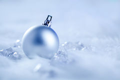 Christmas silver bauble on fur snow and ice Royalty Free Stock Photos