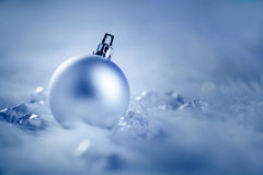 Christmas silver bauble on fur snow and ice Royalty Free Stock Photo