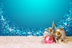Christmas silver bauble and snow isolated on blue . royalty free stock photo