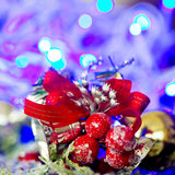 Christmas silver baubles and ornaments against festive lights Royalty Free Stock Image
