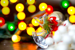 Christmas silver baubles and ornaments against festive lights Royalty Free Stock Images