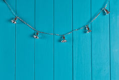 Christmas silver bell on blue wall Stock Photos