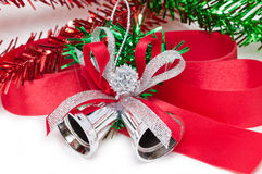Christmas Silver Bell With Red Ribbon. Stock Photo