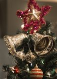 Christmas Silver bell and star hanging on a beautiful Chrismas t Royalty Free Stock Photo