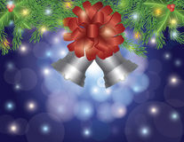 Christmas Silver Bells with Bow On Garland Stock Photo
