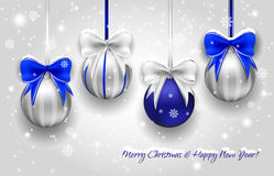 Christmas silver and blue decorative balls. With falling snowflakes. Vector illustration. EPS 10 vector illustration