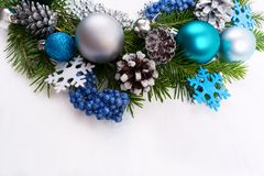 Christmas silver, blue, turquoise baubles on white background royalty free stock photo