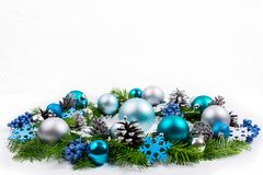 Christmas silver, blue, turquoise baubles wreath, copy space. royalty free stock photos