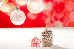 Christmas silver candle and red star on snow Royalty Free Stock Images